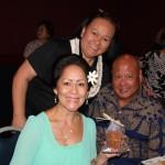"Kenlyn Urasaki KSKʻ79, Pauahi Foundation Director of Alumni Relations Dancine Takahashi KSKʻ79 and Henry Takahashi enjoying the ""KS Brownies"" makana."