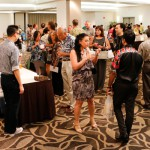Guests mingle while enjoying local chef stations, silent auction, and the mini farmer's market.