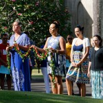 Class of 2000's Tatiana Tseu Fox and Kaʻenaaloha Hopkins offer their hoʻokupu with an ʻoli.