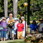 Greg Enos presents the class of 1965 hoʻokupu