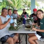 Ceasar Paishon KSK'74, Hope Paishon, Chantelle Fung KSK'04, Melanie Park KSK'00, and Maluhia Maʻa KSK'20 enjoy mea ʻai from Punaluʻu.