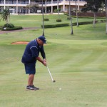 Mason Kuaiwa KSK'84 goes for the green on #18.