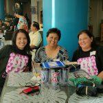 C. Mimi Nishimura KSK'91, Faye Campbell Aki KSKʻ71 and Christine Palmer Hopkins KSK'91 at the 2016 Reunion Challenge Mahalo gathering.