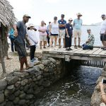 Keliʻi discusses the restoration project, which includes a mākāhā (sluice gate) and hale (house).
