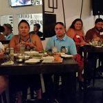 Alumni gather for Hawaiʻi Alumni Reunion Weekend Warrior Networking in Hilo Town. Crystal Kua KSK'81 KS Communications, Malia Tallett KSK '01, Ronald Brummett, Kristen Kahaloa KSK '01, Ilihia Gionson and Justin Pequeno, CE&R East Hawaiʻi Project Manager.