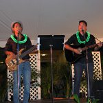 "Kalei Dudoit KSK'07 and classmate rendition of ""Pua Hei"" serenade the audience with their nahenahe voices"