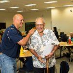 Director of Alumni Relations, Pono Maʻa KSK '82 and Peter Kama KSK '53